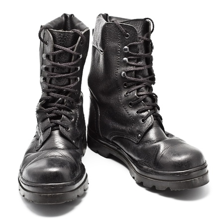 black leather army boots isolated on white photo