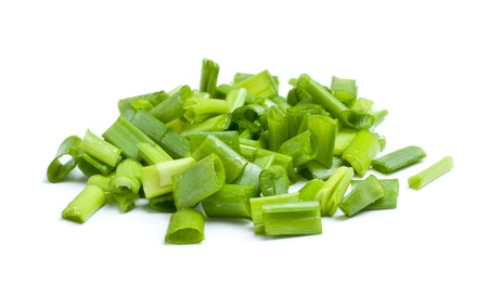odorum: fresh chopped green onions isolated on white