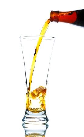 beer pouring from bottle into glass isolated