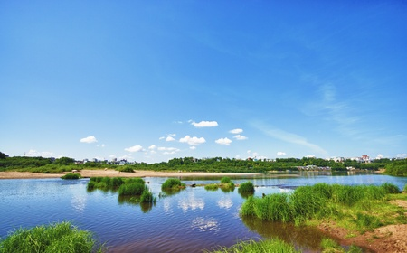 calm river under blue sky at summer day Stock Photo - 10931250