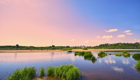 calm river under blue sky at summer day