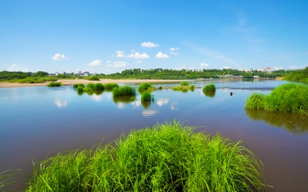 calm river under blue sky at summer day Stock Photo - 10931192
