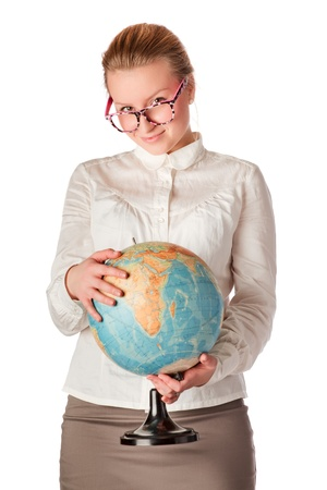 pretty teacher with globe looking, white background photo