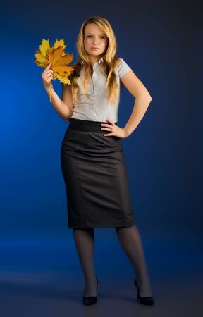 pretty teacher with maple leaves, blue background Stock Photo - 11158093