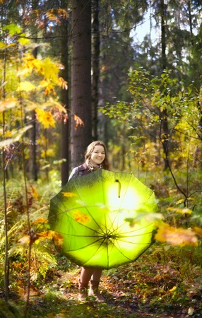 beautiful girl with long hair in autumn rainy forest Stock Photo - 11646848