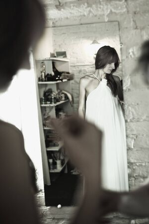 beautiful bride in front of mirror, black and white photo