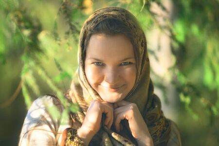 beautiful russian peasant girl in spruce forest photo