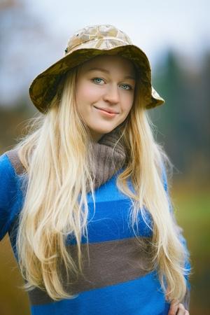 beautiful girl with long blond hair fishing photo