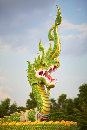 green water dragon statue in Krabi, Thailand photo