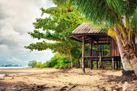 beach and hut in jungle, Koh Lanta, Thailand photo