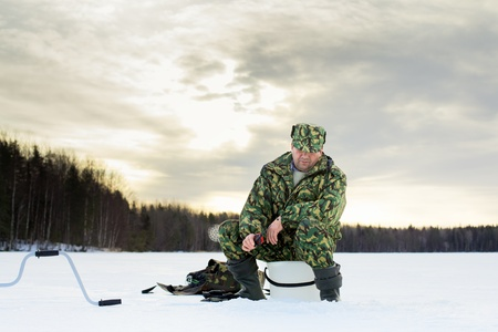 man fishing on the lake at winter Stock Photo - 12998156