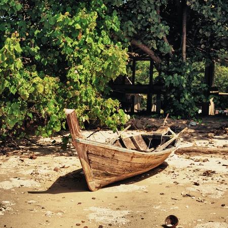 old fishing boat on coast, Koh Libong, Thailand photo