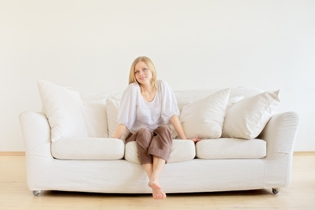 cute young girl relaxing on couch at home Stock Photo