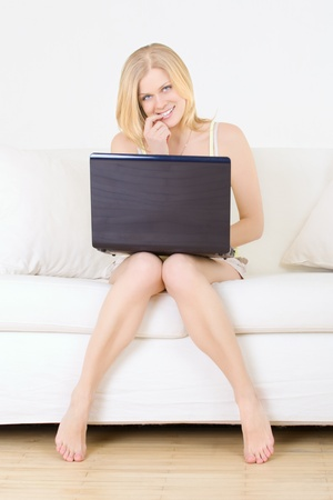cute girl with laptop look something interesting photo