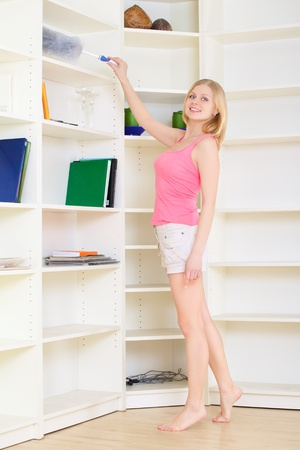 messy room: gorgeous blond housewife at homework in bright room