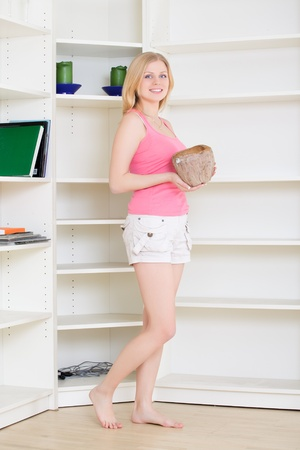 gorgeous blond housewife at homework in bright room photo