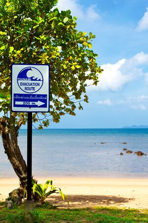 tsunami evacuation route sign on a beach, Thailand photo
