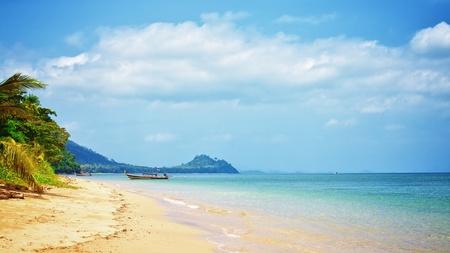 tropical beach with palm, Andaman Sea, Thailand Stock Photo