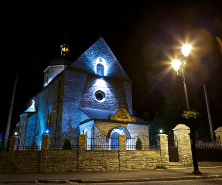 Trinity Church in Kamianets-Podilskyi, Ukraine, at night photo