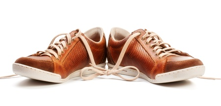 brown leather trainer shoe isolated on white photo