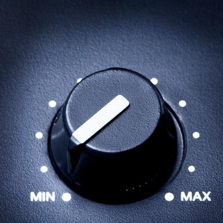 black olume knob on minimum, close up Archivio Fotografico