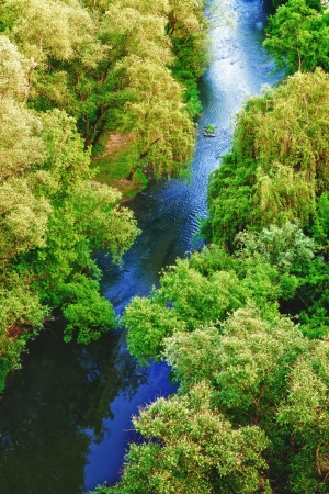 angle views: river in deciduous forest, aerial view, summer day Stock Photo