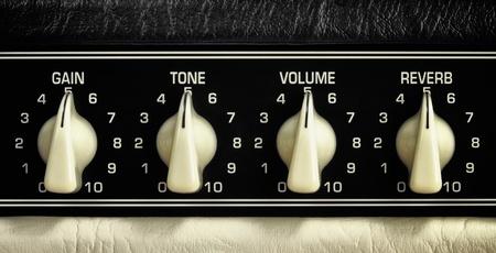 retro guitar amplifier control panel, middle position, close up photo