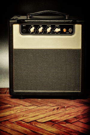 black vintage guitar aplifier on a floor photo