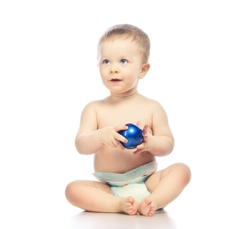 baby playing with christmas ball, isolated on white Stock Photo - 17407685