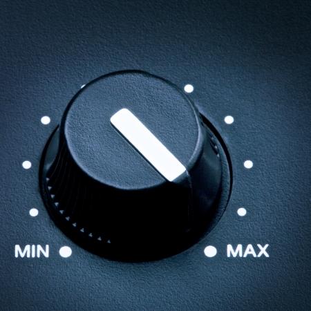 black olume knob on maximum, close up