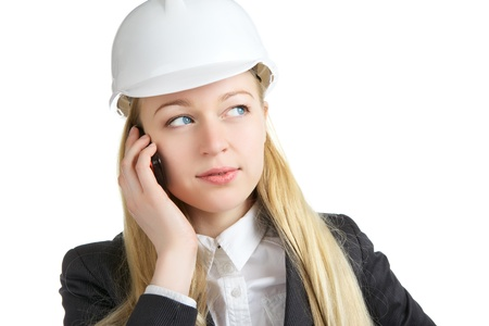 engineer woman talking on cell phone, isolated on white photo