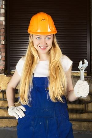 beautiful blond woman with wrench in his hand photo