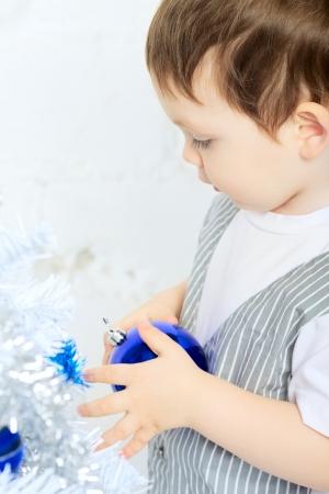 beautiful happy small kid decorate christmas tree Stock Photo - 17408178