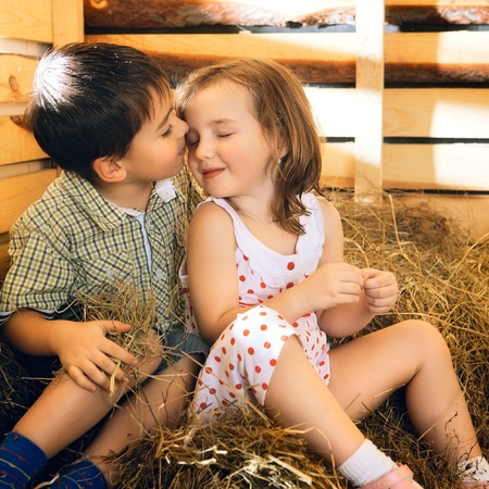hayloft: beautiful children on hayloft at sunny day