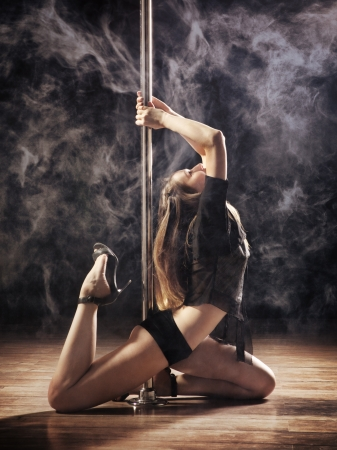 young sexy pole dance woman, dark background Stock Photo - 17538386