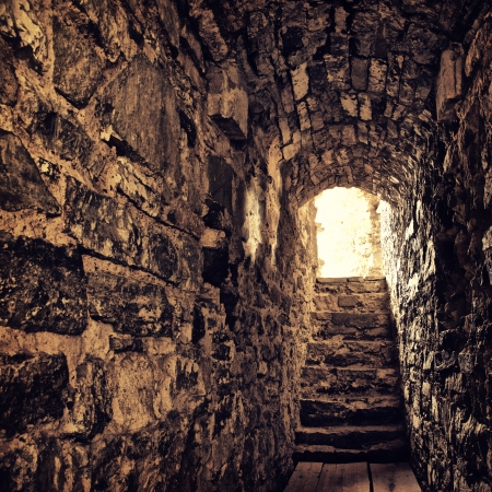 long stone corridor with stairway in ancient castle