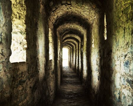 long stone corridor with windows in ancient castle Stock Photo - 17586081