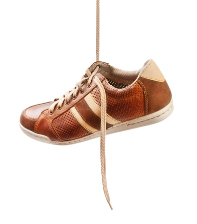 brown leather trainer shoe isolated on white Stock Photo - 17599055