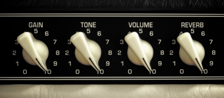 retro guitar amplifier control panel, maximum position, close up photo