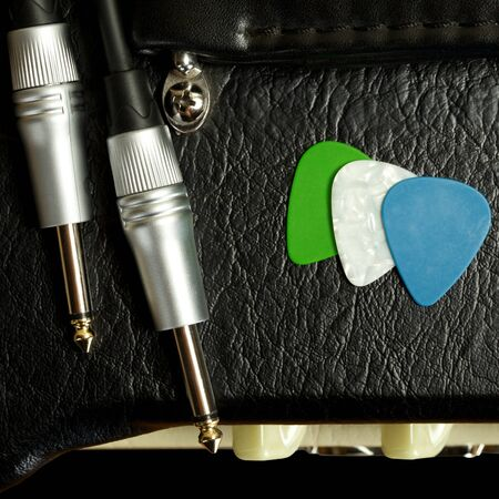 guitar amplifier with cable jack and plectrums, closeup Stock Photo - 17599142