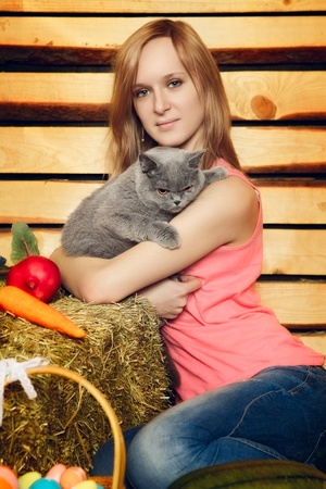 hayloft: beautiful girl with cat on hayloft at summer day