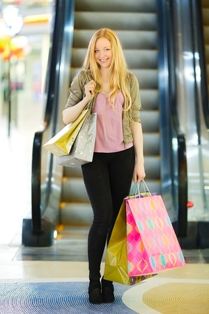 happy girl with shopping bags in shop photo