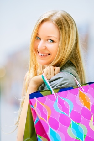 happy girl with shopping bags in shop Stock Photo - 19516083