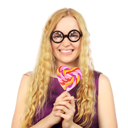 girl in funny eyeglasses with lollipop, isolated on white photo