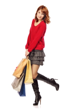 happy girl with shopping bags, isolated on white photo