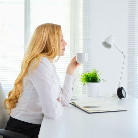 businesswoman legs: happy office girl drink coffee at break