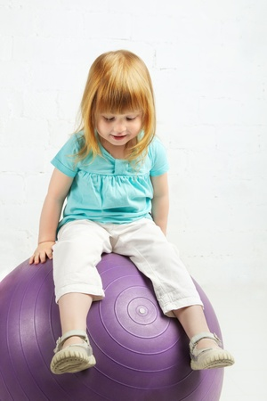 beautiful little girl sitting on big ball Stock Photo - 19516136