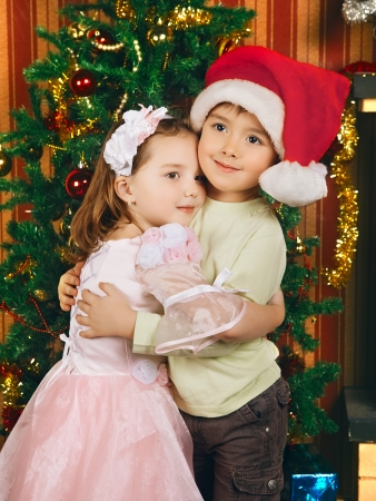 two beautiful child stand near christmas tree Stock Photo - 19516238