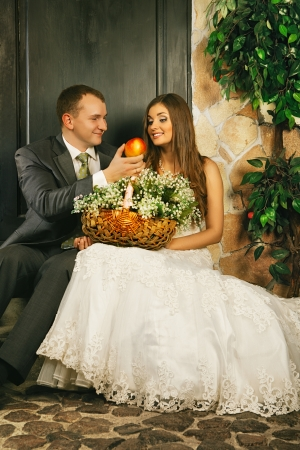 charming bride and groom on porch of house photo
