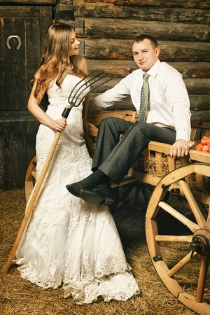 hayloft: charming bride and groom in hayloft at summer day